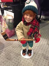 "15"" PORCELAIN HOCKEY BOY DOLL ON ICE SKATES WITH HOCKEY STICK ON STAND"