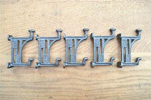 A set of 5 Arts & Crafts Mackintosh Glasgow coathooks cast iron coat hook hanger