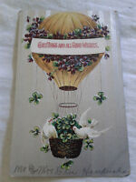 Postcard Greetings and All Good Wishes Hot Air Balloon Doves Clovers Flowers VTG