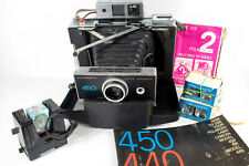 Vintage Polaroid 450 Automatic Land Camera with flash attachment and film
