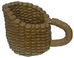 Pitcher made from bottle caps, with very good form, paint, old oxidized gold.