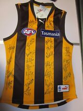 Hawthorn FC - 2013 AFL Premiers - Team signed jersey.  COA & Photo Proof