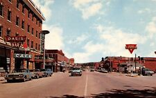 LUSK, WY ~ MAIN STREET, CARS, ADVERTISING & CONOCO GAS SIGNS, c 1950's