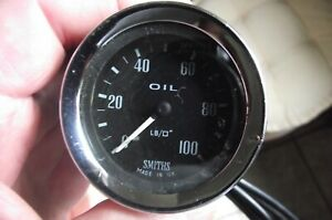 Genuine Smiths full face oil pressure gauge with supply tube.