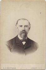 CABINET CARD, GENTLEMAN WITH INTENSE STARE AND A LARGE GOATEE. LIBERTY NY.