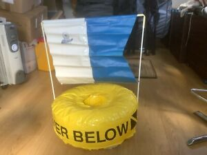 Diver below ring and A flag. Yellow circular buoy with closed centre