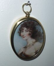 Portrait Miniature of beautiful girl in Empire style dress in oval brass frame