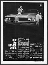 """1969 Oldsmobile 442 Coupe photo """"Built Like a 1 3/4 Ton Watch"""" vintage print ad"""