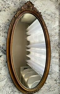 Antique oval big wooden ramed mirror with floral patterns