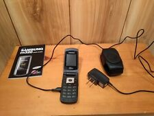 Vintage Samsung m320 flip phone with charger, manual, Roots phone case