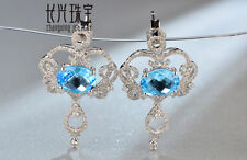 14kt White Gold 7x9mm Oval Cut 4.52ct Natural Blue Topaz Diamond Earring
