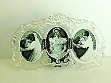 """Clear Glass Photo Frame Raised Scrolls Motif  Holds Three 4 x 3""""  Oval Photos"""