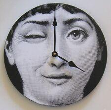 Wall clock.  Fornasetti digital image of a woman winking.