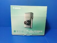 New in Box- Canon PowerShot Elph SD1300 IS 12.1MP Camera - SILVER - 013803119534