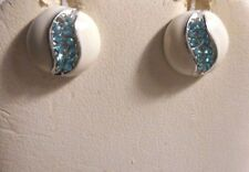 Silver tone earrings white enamel and a slit of blue crystals