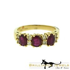 Gorgeous Three Round Ruby and Diamond Half Eternity Ring in Yellow Gold