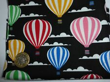 1 metre cotton poplin with bright coloured striped balloons on black