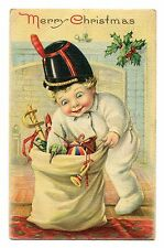 1924 Merry christmas postcard little boy going through bag of toys serie 744