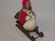 Byers Choice Cute Toddler in Red Snowsuit with Dog on Sled