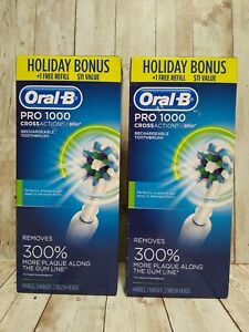 (2) Oral-B Pro 1000 CrossAction Electric Toothbrushes Holiday Bonus Free Refill
