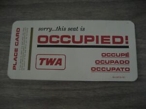 TWA. SEAT OCCUPIED SIGN