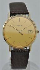 Tissot solid 14K gold gents dress quartz watch.