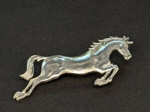 A 1960 silver George Tarrot stallion horse pin brooch signed & numbered