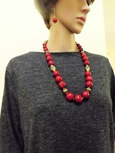 One of a kind genuine coral necklace and earrings set.