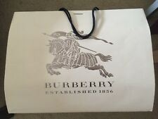 "Burberry Beige Paper Shopping Bag measures approximately 21"" x 16"" x 7"""