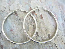 10KT White Gold Hoop Shiny & Diamond Cut Polished Hoop Style Earrings.....Defect