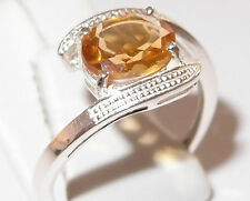 Oval Citrine twist solitaire in rhodium plated Sterling Silver, 1.75ct. Size Q.