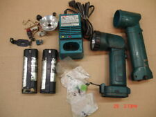 Makita charger Model DC9700a and flashlight lot for parts
