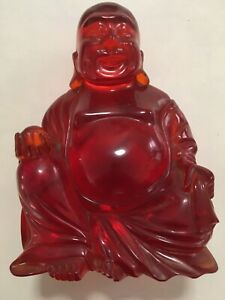 Chinese Red Amber Resin Buddha on Wooden Stand
