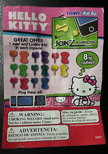 Tomy Gacha Hello Kitty JakZ and Cable Tidy Vending Capsule