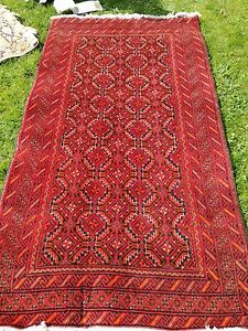 Hand knotted middle eastern runner woollen geometrical patterned rug