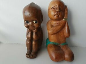 A PAIR OF HAND CARVED WOODEN ETHNIC FIGURES OF BOYS