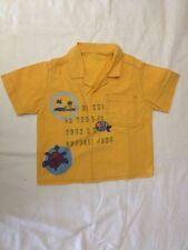 Camicia arancione con scritte e disegni - senza etichette - senza taglia - Usata