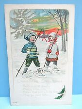 "VTG 1900's NOS - EMBOSSED  PC - GIRL & BOY IN SNOW SHOES ""CHRISTMAS GREETINGS"""