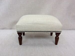 Footstool upholstered in a Laura Ashley fabric Dalton pale natural