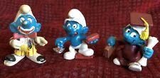 Smurf figures, clown, bricklayer, scholar
