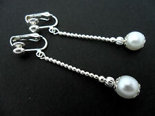 A PAIR OF LOVELY  SILVER PLATED WHITE PEARL BEAD DROP CLIP ON EARRINGS. NEW.