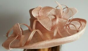 Stunning rose pink straw hat with floral decoration, beads and swirls