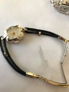 vintage watch Ladies , Hamilton   14 Kt Gold  ..