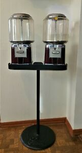 1960'S CURTIS TWIN GUMBALL MACHINES ON ORIGINAL STAND BY BEAVER MACHINE-O-MATIC