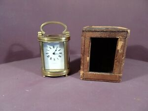 BRASS OVAL CARRIAGE CLOCK, RETAILED BY HARRODS, WITH ORIGINAL CASE