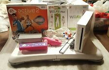 Nintendo Wii Game System with Wii Fit Plus Game and Balance Board and Active 2