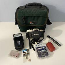 Nikon FM10 35mm SLR Film Camera with Nikon 35-70 mm lens And More EXTRAS RARE