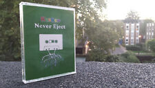 """Keshco """"Never Eject"""" audio tape + wooden tape art object - collectible twin-pack"""
