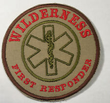 "WILDERNESS FIRST RESPONDER PATCH (TAN), red lettering Hook & Loop Back 4"" Dia."