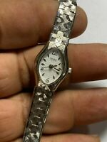 Ladies Silver Tone Caravelle By Bulova A4 Analog Watch
